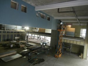 Looking down onto the Hall and Dining Area from behind the stage proscenium arch at first floor level.