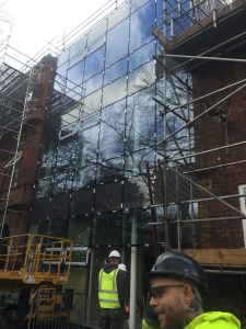 The extension's glass-front is complete (G.cam).