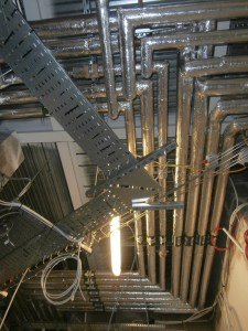 A network of heating pipes near the new side door.
