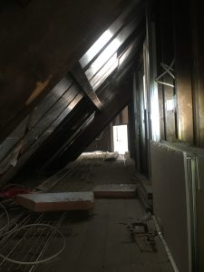 The west eaves are being insulated (above)and the north gable eaves room is now being sealed off (below).