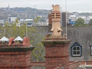 A Victorian terracotta chimney pot on the east gable.