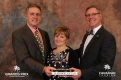 Churchill Wild co-owners Mike (left) and Jeanne Reimer receiving Adventure/Outdoors Award from David McKenna, President of Brewster Travel Canada, at the 2016 Canadian Tourism Awards. Photo courtesy of TIAC.