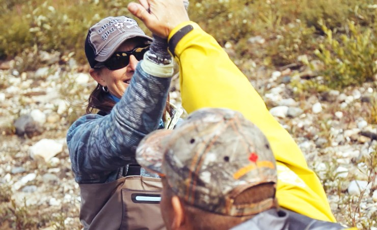 Lori Ginn gets a high-five from lodge manager and guide Nolan Booth.