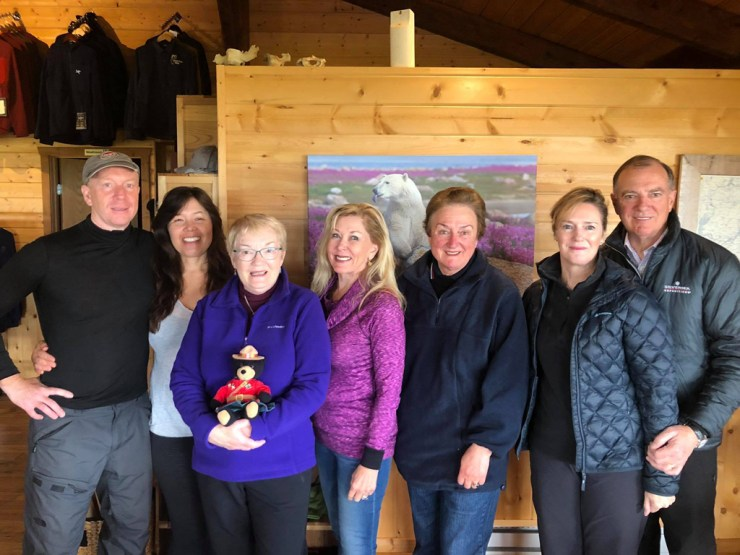 Dynie Sanderson (center, in purple) with new friends at Nanuk Polar Bear Lodge.
