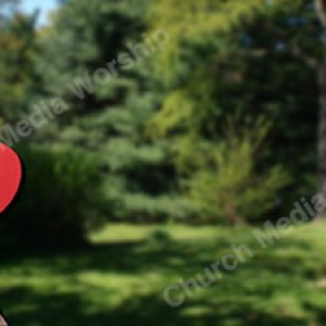 Child holding paper heart Blank Christian Worship Background. High quality worship images for use to spread the Gospel and enhance the worship experience.