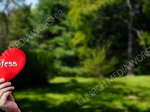 Child holding paper heart - Confess Christian Worship Background. High quality worship images for use to spread the Gospel and enhance the worship experience.