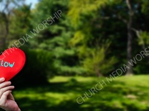 Child holding paper heart - Follow Christian Worship Background. High quality worship images for use to spread the Gospel and enhance the worship experience.