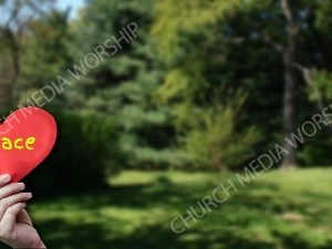 Child holding paper heart - Peace Christian Worship Background. High quality worship images for use to spread the Gospel and enhance the worship experience.