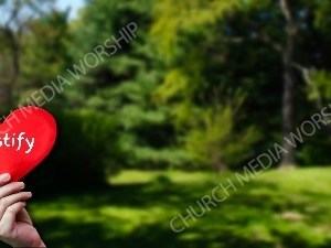 Child holding paper heart - Testify Christian Worship Background. High quality worship images for use to spread the Gospel and enhance the worship experience.