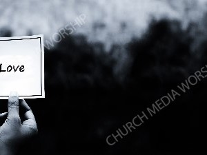 Hand holding note BandW - Love Christian Worship Background. High quality worship images for use to spread the Gospel and enhance the worship experience.