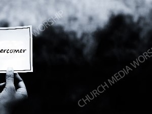 Hand holding note BandW - Overcomer Christian Worship Background. High quality worship images for use to spread the Gospel and enhance the worship experience.
