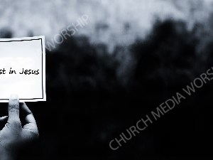 Hand holding note BandW - Trust in Jesus Christian Worship Background. High quality worship images for use to spread the Gospel and enhance the worship experience.