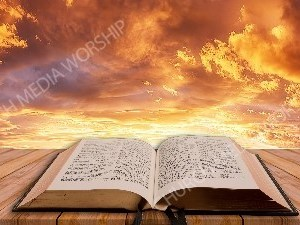 Open Bible on table - Sunset 1 Christian Worship Background. High quality worship images for use to spread the Gospel and enhance the worship experience.