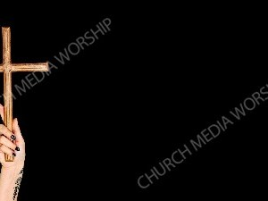 Tattoo hand holding wood cross - black Christian Worship Background. High quality worship images for use to spread the Gospel and enhance the worship experience.