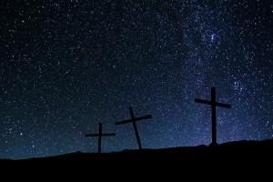 Crosses on a hill on a background of stars