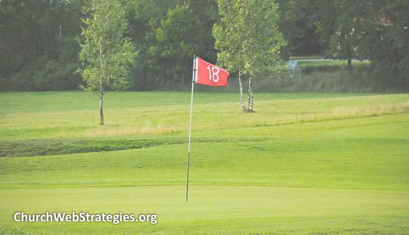 18th hole flag on golf course