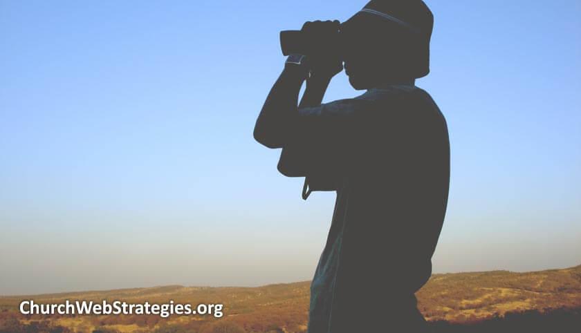silhouette of person looking through binoculars
