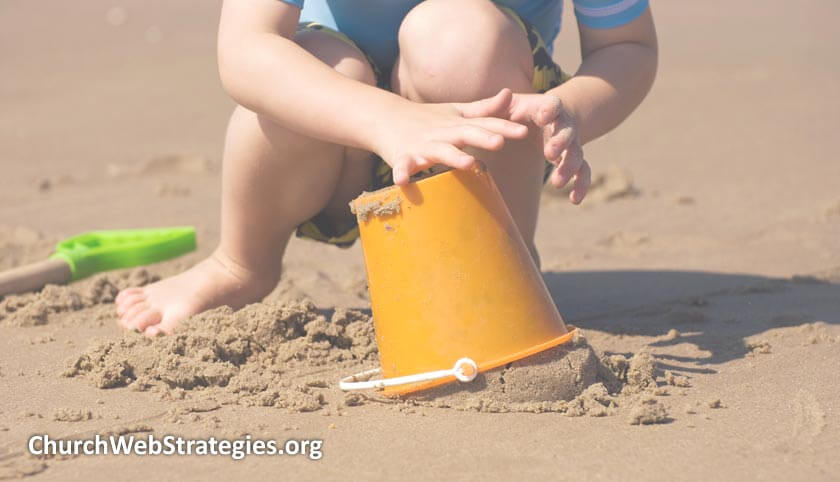 child playing in sand on a beach