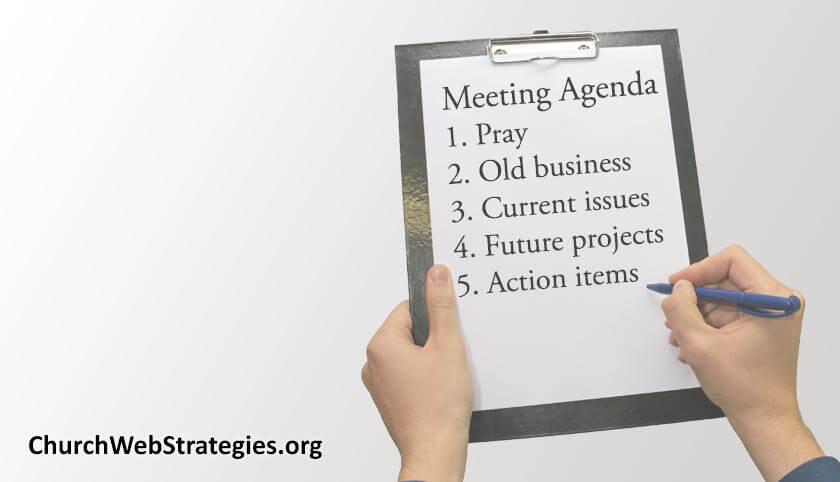 Clipboard with meeting agenda items