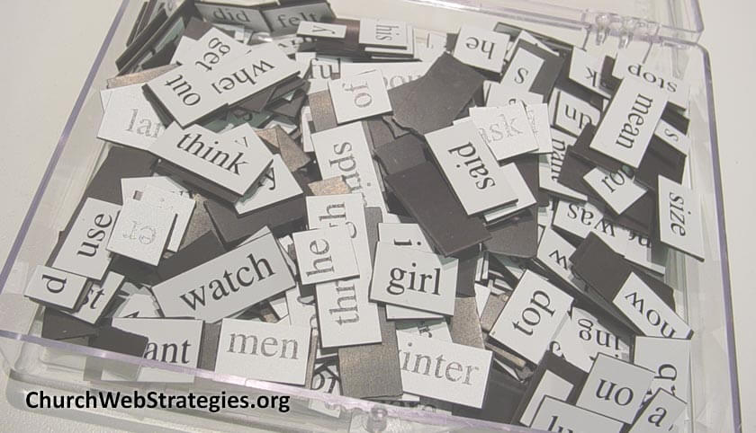 bin of magnets with words on them