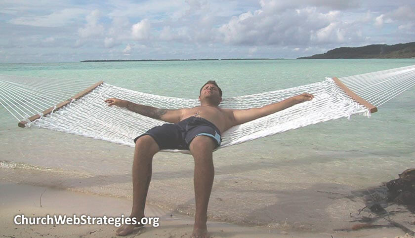 many laying on hammock on the beach