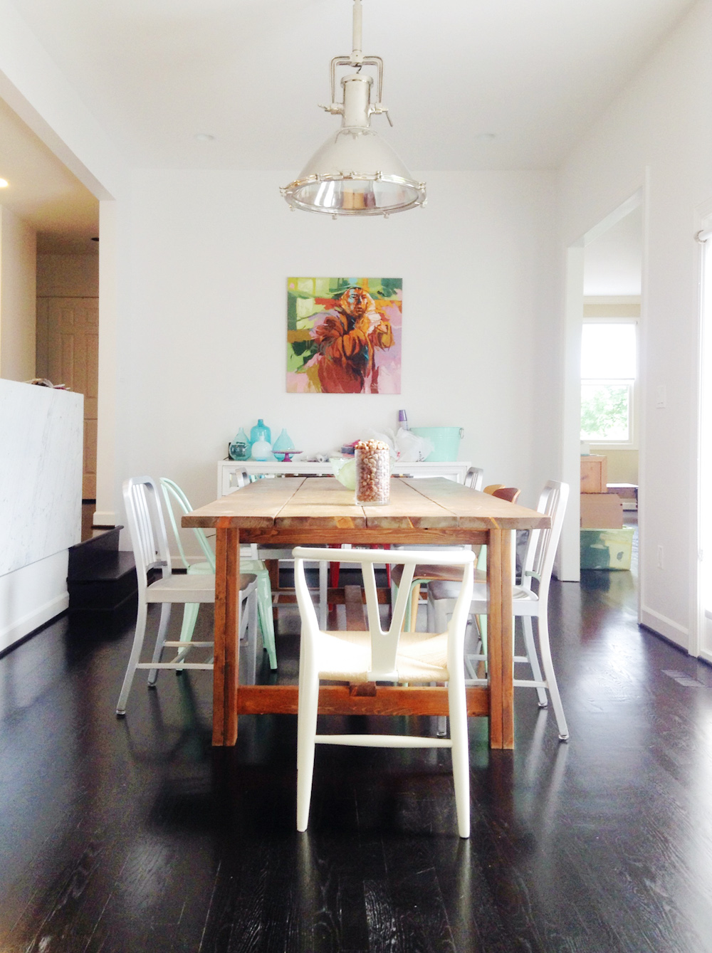 Beautiful white kitchen dining table with mixed chairs for Beautiful white dining rooms