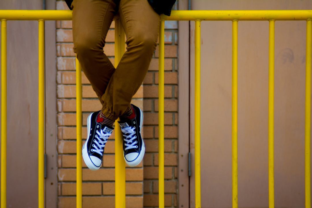 jobs for senior high school graduates, a fresh graduate is sitting on top of the yellow railing