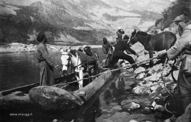 Transporting a horse across the river by canoe