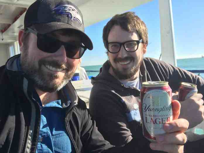 Brother-in-laws deep sea fishing together and sharing beer