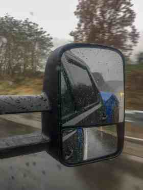 truck mirror in the rain while moving