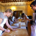 Fattoria del Colle guests learning how to make pici