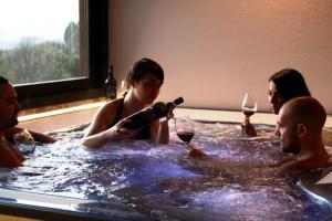 wellness-and-wine-toastingin-the-jacuzzi-at-Fattoria-del-Colle