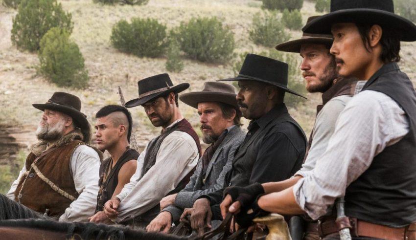 (L-r) Vincent D'Onofrio, Martin Sensmeier, Manuel Garcia-Rulfo, Ethan Hawke, Denzel Washington, Chris Pratt and Byung-hun Lee star in Columbia Pictures' THE MAGNIFICENT SEVEN.