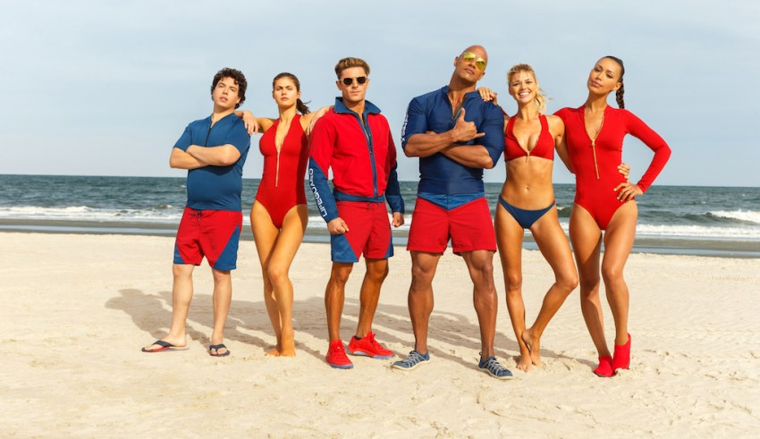 (L-r) Jon Bass, Alex Daddario, Zac Efron, Dwayne Johnson, Kelly Rohrbach, Ilfenesh Hadera star in Paramount's BAYWATCH