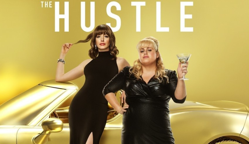 Poster image of Anne Hathaway and Rebel Wilson in United Artists' THE HUSTLE
