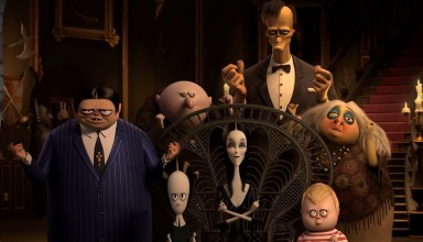 (L to R) Oscar Isaac as the voice of Gomez Addams, Chloë Grace Moretz as the voice of Wednesday Addams, Nick Kroll as the voice of Uncle Fester, Charlize Theron as the voice of Morticia Addams, Conrad Vernon as the voice of Lurch, Finn Wolfhard as the voice of Pugsley Addams, and Bette Midler as the voice of Grandma in Columbia Pictures' THE ADDAMS FAMILY