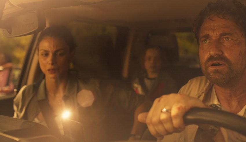 (L-R) Morena Baccarin, Roger Dale Floyd and Gerard Butler star in STX Films' GREENLAND
