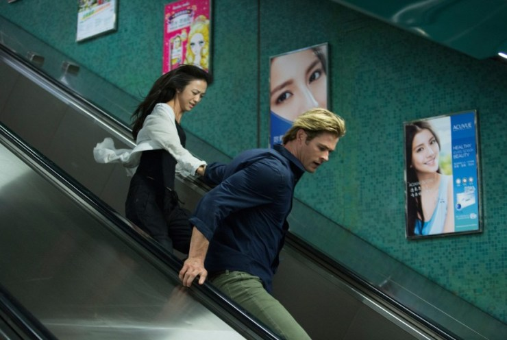 "This photo provided by Universal Pictures shows, Tang Wei, left, as Chen Lien, and Chris Hemsworth, as Nicholas Hathaway in Legendary's film, ""Blackhat,"" from director/producer Michael Mann. (AP Photo/Legendary Pictures - Universal Pictures, Frank Connor)"