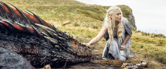 "In this image released by HBO, Emilia Clarke appears in a scene from ""Game of Thrones. Clarke was nominated for an Emmy Award on Thursday, July 16, 2015, for outstanding supporting actress in a drama series for her role on the show. The 67th Annual Primetime Emmy Awards will take place on Sept. 20, 2015.  (HBO via AP)"
