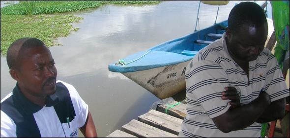David Kilo, right, sits in his office on a pier at Lake Naivasha