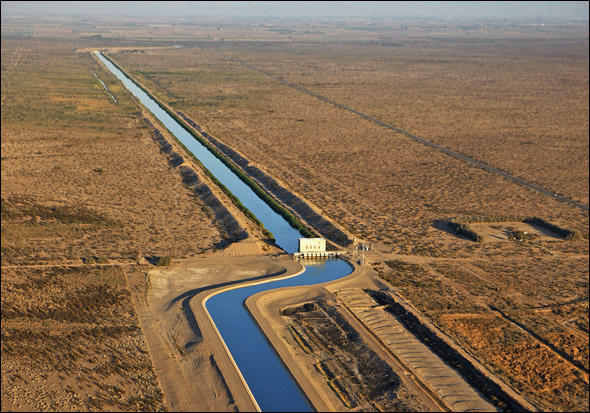The All-American Canal, the main water conduit from the Colorado River into the Imperial Dam, flows through the Imperial Valley, Calif.  The U.S. consumes about 100 billion gallons of water a day. Nearly 85 percent is used for crop and livestock production. Of the 16.1 billion gallons that remain, half is devoted to producing energy.