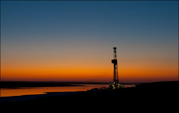STANLEY, NORTH DAKOTA, SEPTEMBER 2009: An oil drilling rig on the Bakken Shale formation at sunset.