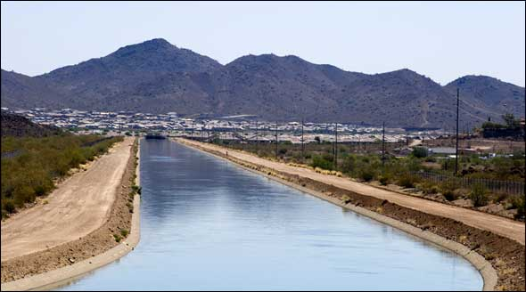 The Central Arizona Project canal system runs 336 miles from Lake Havasu, on the California border, to Tucson, providing water to nearly 80 percent of the state's residents.
