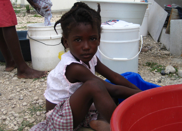 Haiti cholera earthquake health disease epidemic outbreak tent camp water sanitation latrine