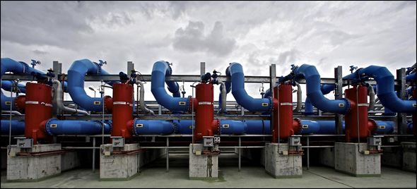 Giant chambers capture the largest impurities from incoming wastewater after basic sewage treatment.