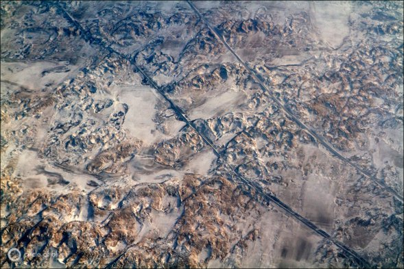 Roads and rails cross the rugged terrain of Inner Mongolia on the route between Beijing and Xilinhot, a likely path for the proposed 600km-long pipeline that will transfer water from the Bohai Sea. Photo copyright J. Carl Ganter / Circle of Blue