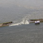 An aerial view of an intentional breach in levee L-575 near Hamburg, Iowa, June 20. The intentional breach was created by the local sponsor and approved by the U.S. Army Corps of Engineers following a full breach of the levee June 13. The intentional breach was conducted by the sponsor to delay the time in which the area behind the levee would flood. The levee is located at River Mile 552 in Atchison County, Mo. (U.S. Army Photo)