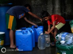water container Cuatro east zone manila water station philippines Filipino squatter village