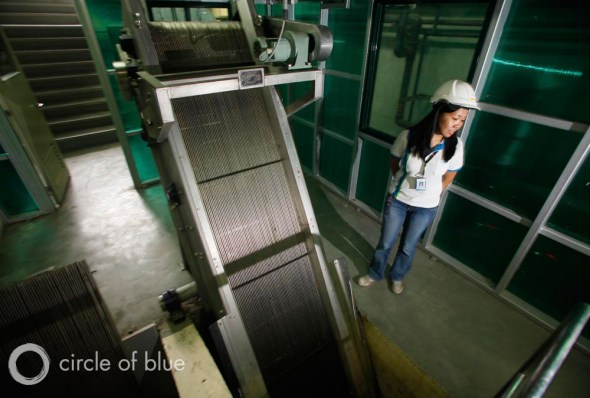 A Manila Water Company representative gives a tour of one of the company's wastewater treatment plants, located along the banks of the Pasig River.