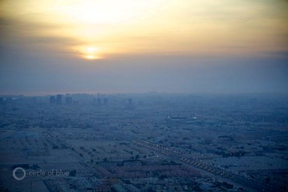 Qatar Doha suburbs sunrise fossil fuel wealth water scarce